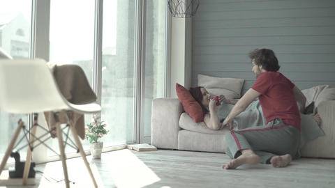 A guy and a girl in the morning at dawn. Couple. Relations. Romance. Slow motion Live Action
