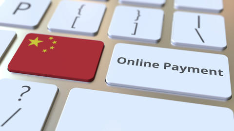 Online Payment text and flag of China on the keyboard. Modern finance related Live Action