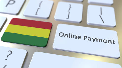 Online Payment text and flag of Bolivia on the keyboard. Modern finance related Live Action