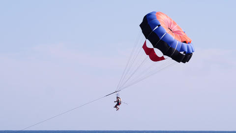 Couple tourists on a parachute over the sea. Parasailing in the red sea Live Action