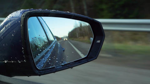 Rear view mirror reflections driving on highway near Helsinki in Finland Live Action