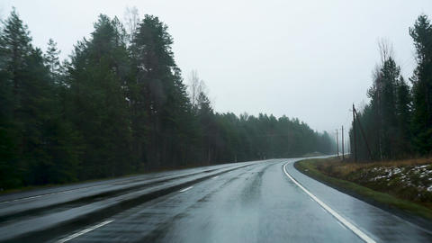 Driving on rainy autumn road in Finland car windscreen view Live Action