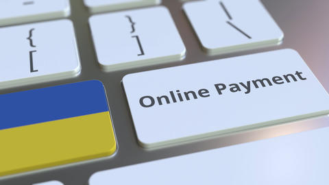 Online Payment text and flag of Ukraine on the keyboard. Modern finance related Live Action