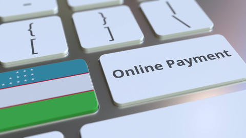 Online Payment text and flag of Uzbekistan on the keyboard. Modern finance Live Action