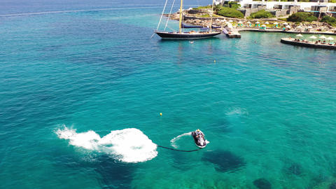 Aerial view of a person flyboarding in the sea. Elounda, Crete, Greece Live Action