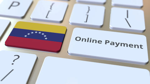 Online Payment text and flag of Venezuela on the keyboard. Modern finance Live Action