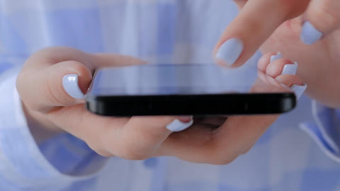 Close up view - woman using smartphone with touchscreen display Live Action