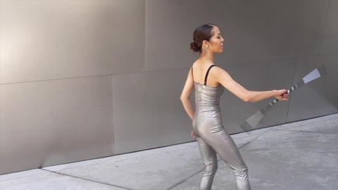 Female Asian Dancer Baton Twirler Circus Performer Live Action