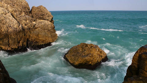Blue sea ocean waves crash into the rocks. Sunny summer day sea wave landscape Live Action