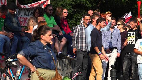 Meeting in Warsaw. Demonstration of disgruntled people. Poland. 4K Footage