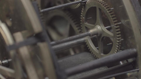 An inside view macro shot of an antique vintage clock with a detailed depiction of the tick-tock Live Action