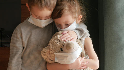 kids, children with protective masks with teddy bead, home quarantine Live Action