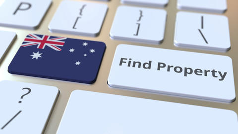 Find Property text and flag of Australia on the keyboard. Online real estate Live Action