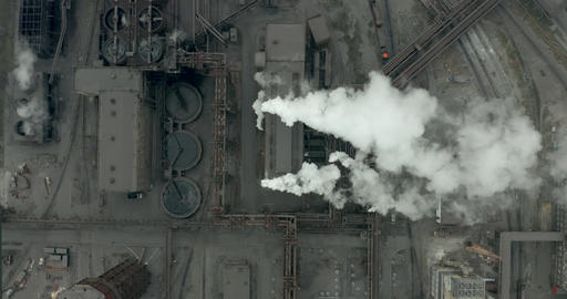 Epic aerial of high pipes with smoke emission. Plant pipes pollute atmosphere Live Action