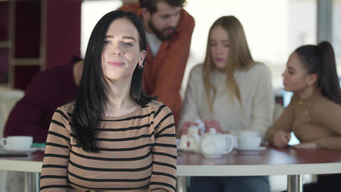 Portrait of joyful adult Caucasian girl with black hair looking at camera and Live Action
