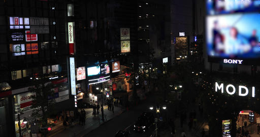 A night cityscape from falling elevator at the urban city in Tokyo high angle Live Action
