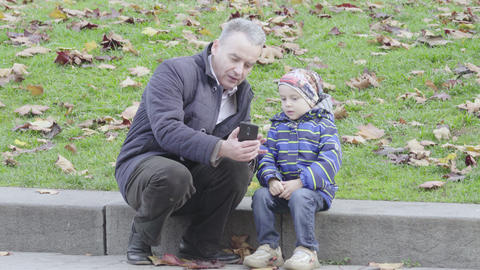Cityscape of Kyiv. Ukraine. People on a city street. Grandfather and grandson Live Action