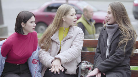 Cityscape of Kyiv. Ukraine. People on a city street. Young girls on a bench Live Action