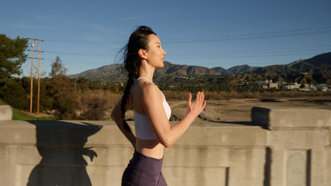 Attractive asian woman going for her morning run Live Action