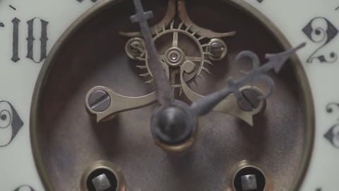 Macro shot of an antique clock with a detailed depiction of the clock face Live Action