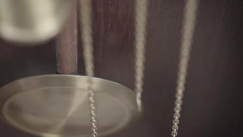 Macro shot of an antique vintage clock with a pendulum in motion Live Action