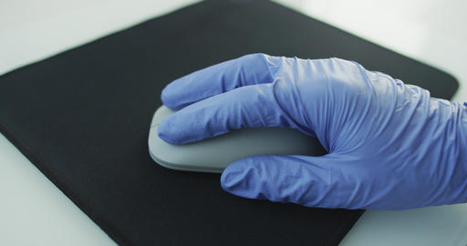 Doctor or nurse or office worker using protective gloves while using computer Live Action