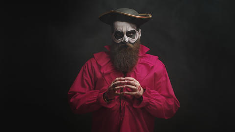 Adult man with long beard dressed up like a spooky captain Live Action