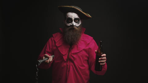 Man dressed up like a drunk pirate over black background Live Action