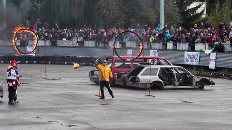 Stuntman performs double jump through fire circles, multi-angle Footage