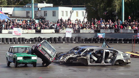Retro car stunt show sequence, two-wheel driving, sporting event Live Action