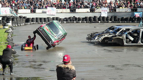 Stuntman performing death-defying stunt at extreme auto show Live Action