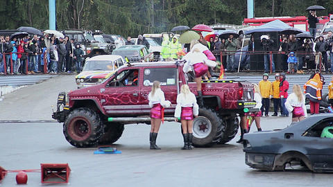 Girls cheerleaders mini skirts jump off Bigfoot car, stunt show Live Action