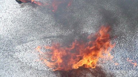 Closeup gasoline puddle on fire, burning liquid, accident, crash Footage