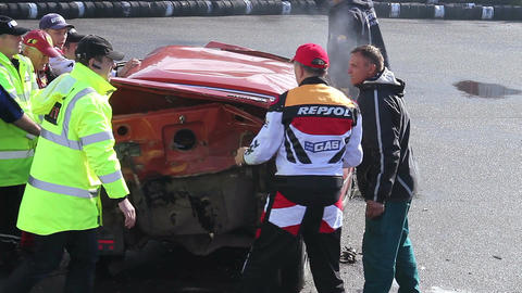 Rescue team turning wrecked car around at extreme stunt show Footage