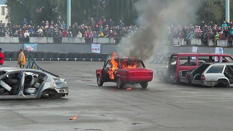 Audience watches car burning, explosion with sound, fire stunt Footage