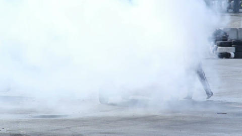 Man extinguishing car fire after crash, accident, thick smoke 影片素材