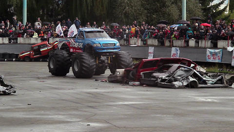 Bigfoot monster truck entertaining audience, sporting event Live Action