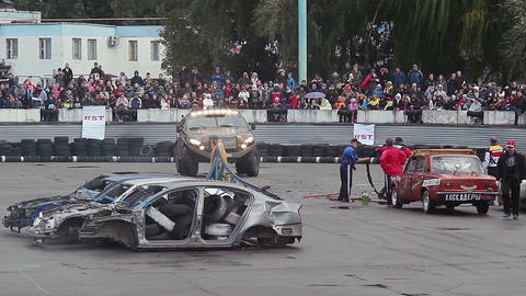 Custom built monster truck drifting, circling in front of crowd Footage