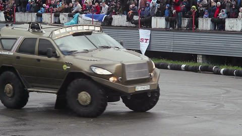 Demonstration of military monster truck at extreme stunt show Live Action