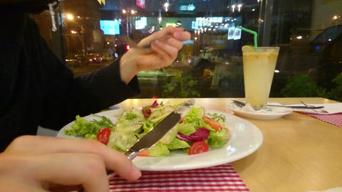 Guy enjoying appetizing salad, eating out, having low-fat dinner Footage