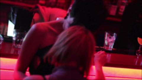 Sexy girls, lesbians kissing, hugging, touching, dancing at bar Footage