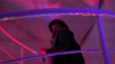 Woman entering night club, people walking upstairs, downstairs Footage