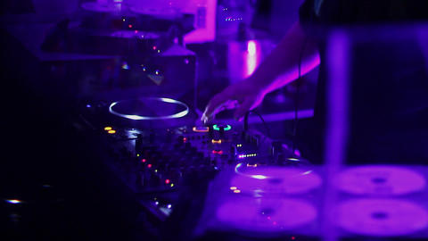 Male disk jockey hands playing tracks, people clapping, dancing Footage