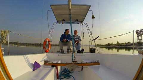 Two yachtsmen sitting and talking. Yachting, outdoor activities Footage