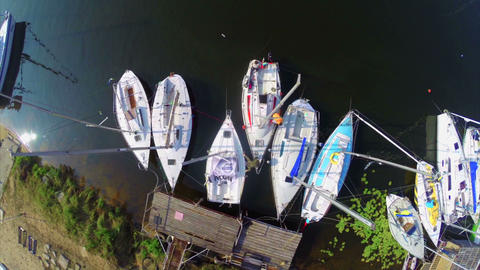 Aerial vertical view of moored sailboats in harbor, yachting Footage