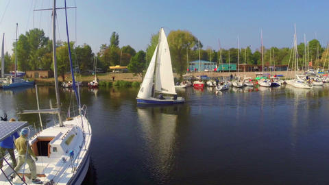 Sailing yacht leaves small harbor, adventure, tourism, traveling Footage