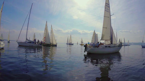 Sea on summer sunny day, sailing yachts floating on water Footage