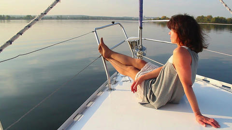 Young beautiful girl enjoying vacation on luxury yacht, tourism Footage