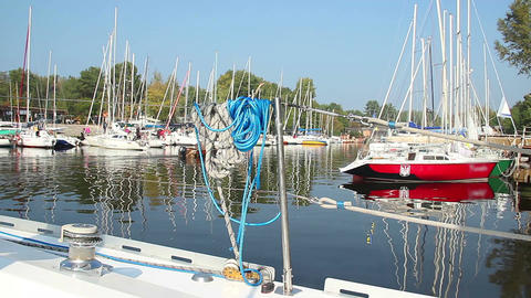 Harbor on summer day, moored sailboats in dock, yachting Footage