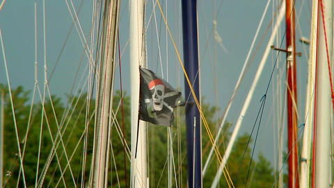 Black pirate flag on the wind, skull and crossbones, yachting Footage